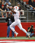 Illinois quarterback AJ Bush Jr. celebrates as he scores a touchdown against Rutgers during the first half of an NCAA college football game Saturday, Oct. 6, 2018, in Piscataway, N.J. (AP Photo/David Boe)