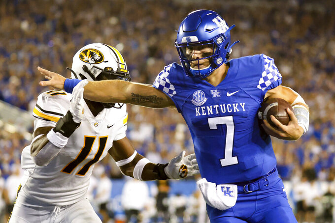 Kentucky quarterback Will Levis (7) stiff arms Missouri linebacker Devin Nicholson (11) on his way into the end zone during the first half of an NCAA college football game against Missouri in Lexington, Ky., Saturday, Sept. 11, 2021. (AP Photo/Michael Clubb)