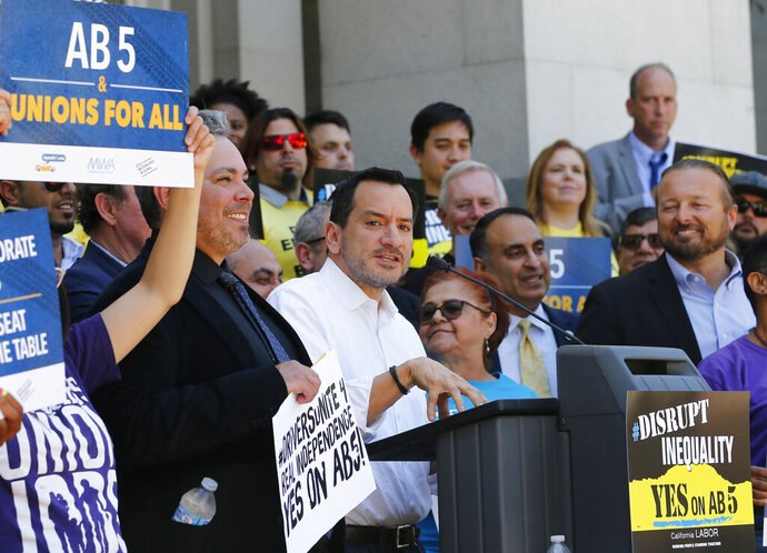 Assembly Speaker Anthony Rendon, D-Lakewood, speaks in support of a bill to limit when companies can label workers as independent contractors, during a rally in Sacramento, Calif., Wednesday, July 10, 2019. The measure, AB5 by Assemblywoman Lorena Gonzalez, D-San Diego, aimed at major employers like Uber and Lyft, was approved by a Senate committee and still needs approval by the full Senate. (AP Photo/Rich Pedroncelli)