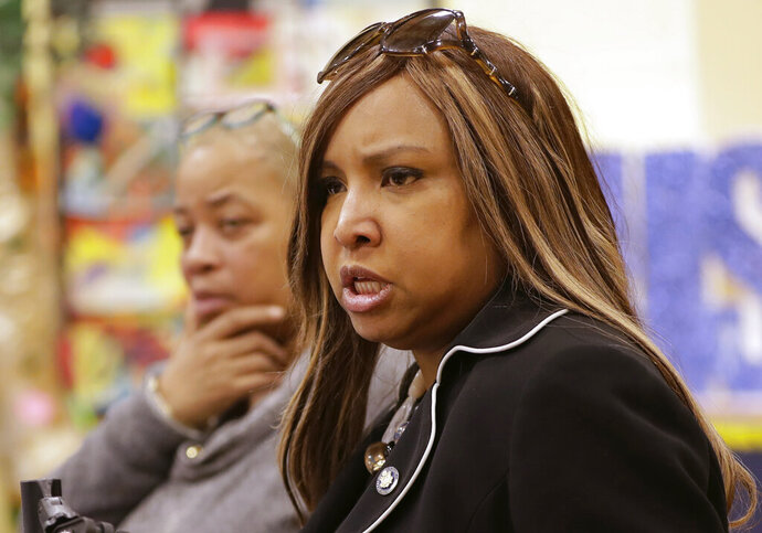 In this March 7, 2019 photo, Queensbridge Houses Tenant Association President April Simpson, left, listens as HUD executive Lynne Patton, conducts a town hall meeting to air residents' concerns at the Queensbridge Houses in New York. Patton spent  a month living in four NYCHA public housing units to learn first-hand basis the problems public housing residents face. (AP Photo/Kathy Willens)