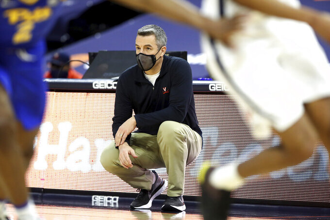 Virginia head coach Tony Bennett watches the court during an NCAA college basketball game against Pittsburgh, Saturday, Feb. 6, 2021, in Charlottesville, Va. (Erin Edgerton/The Daily Progress via AP, Pool)
