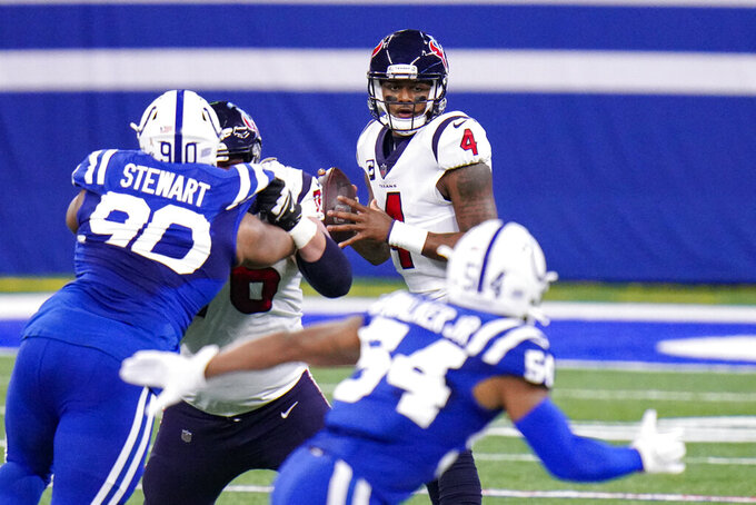 Houston Texans quarterback Deshaun Watson (4) throws against the Indianapolis Colts in the first half of an NFL football game in Indianapolis, Sunday, Dec. 20, 2020. (AP Photo/AJ Mast)