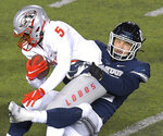Utah State linebacker Nick Heninger tackles New Mexico running back Daevon Vigilant (5) during the first half of an NCAA college football game Thursday, Nov. 26, 2020, in Logan, Utah. (Eli Lucero/Herald Journal via AP)