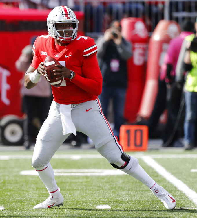 Ohio State quarterback Dwayne Haskins drops back to pass against Minnesota during the second half of an NCAA college football game Saturday, Oct. 13, 2018, in Columbus, Ohio. Ohio State beat Minnesota 30-14. (AP Photo/Jay LaPrete)