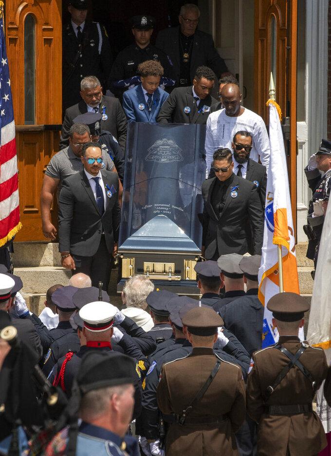 Pall bearers carry the casket of fallen Worcester Police Officer Enmanuel Familia after his funeral Mass in St. John Church in Worcester, Mass. Thursday, June 10, 2021. (Ashley Green/Worcester Telegram & Gazette via AP)