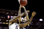 Missouri forward Mitchell Smith (5) and Butler forward Sean McDermott (22) battle for a rebound during the first half of an NCAA college basketball game Monday, Nov. 25, 2019, in Kansas City, Mo. (AP Photo/Charlie Riedel)