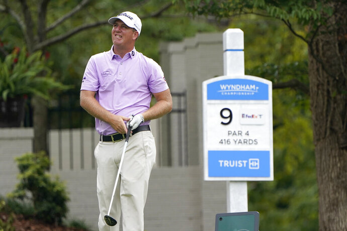Tom Hoge watches his drive on the ninth hole during the second round of the Wyndham Championship golf tournament at Sedgefield Country Club on Friday, Aug. 14, 2020, in Greensboro, N.C. (AP Photo/Chris Carlson)