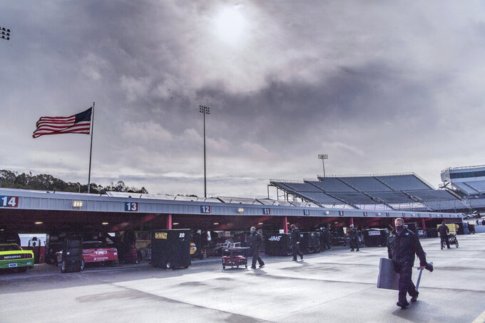 The sun comes out after rain fell prior to a NASCAR Cup Series auto race at Martinsville Speedway in Martinsville, Va., Sunday, Nov. 1, 2020. (AP Photo/Lee Luther Jr.)