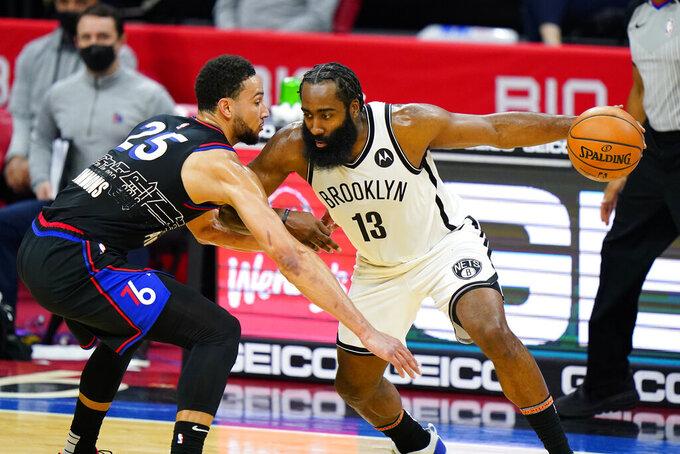 Brooklyn Nets' James Harden (13) tries to drive past Philadelphia 76ers' Ben Simmons (25) during the second half of an NBA basketball game, Saturday, Feb. 6, 2021, in Philadelphia. (AP Photo/Matt Slocum)