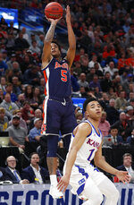 Auburn forward Chuma Okeke (5) shoots over Kansas guard Devon Dotson (11) during the first half of a second-round game in the NCAA men's college basketball tournament Saturday, March 23, 2019, in Salt Lake City. (AP Photo/Jeff Swinger)