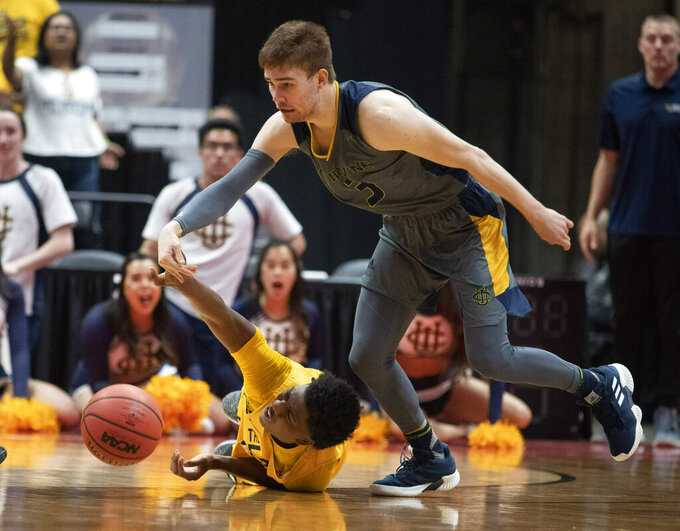 UC Irvine guard Robert Cartwright, right, steals the ball from Long Beach State guard Deishuan Booker during the first half of an NCAA college basketball game at the Big West men's tournament in Anaheim, Calif., Friday, March 15, 2019. (AP Photo/Kyusung Gong)