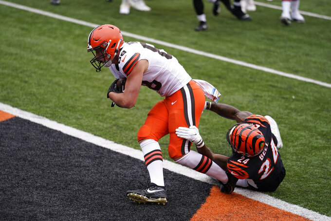 Cleveland Browns' Harrison Bryant (88) scores while being tackled by Cincinnati Bengals' Vonn Bell (24) during the first half of an NFL football game, Sunday, Oct. 25, 2020, in Cincinnati. (AP Photo/Michael Conroy)