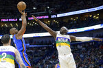 Oklahoma City Thunder guard Chris Paul (3) shoots over New Orleans Pelicans guard Jrue Holiday (11) during the first half of an NBA basketball game in New Orleans, Thursday, Feb. 13, 2020. (AP Photo/Matthew Hinton)
