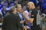 Northwestern coach Chris Collins, center, questions a call from referee D.J. Carstensen,right, during an NCAA college basketball game against Penn State, Saturday, Feb. 15, 2020, in State College, Pa. (AP Photo/Gary M. Baranec)