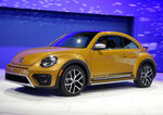 FILE- In this Nov. 18, 2015, file photo the 2017 Volkswagen Beetle Dune is displayed at the Los Angeles Auto Show in Los Angeles. Volkswagen says it will stop making its iconic Beetle in July of next year. Volkswagen of America on Thursday, Sept. 13, 2018, announced the end of production of the third-generation Beetle by introducing two final special editions. (AP Photo/Chris Carlson, File)