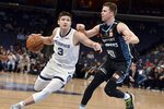 Memphis Grizzlies guard Grayson Allen (3) handles the ball against New Zealand Breakers forward Tom Abercrombie (10) in the first half of an exhibition NBA basketball game Tuesday, Oct. 8, 2019, in Memphis, Tenn. (AP Photo/Brandon Dill)