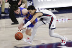 BYU guard Alex Barcello,left, and Gonzaga guard Andrew Nembhard go after the ball during the first half of an NCAA college basketball game in Spokane, Wash., Thursday, Jan. 7, 2021. (AP Photo/Young Kwak)