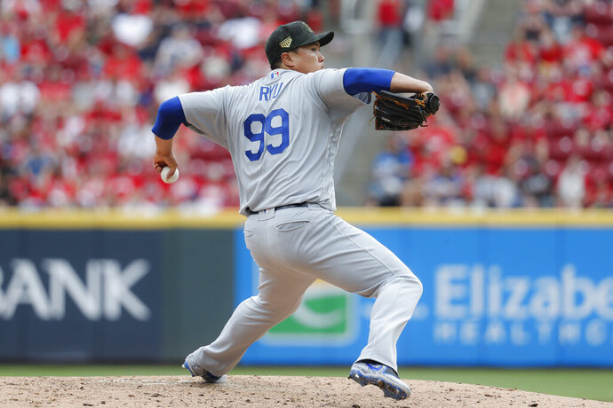 Los Angeles Dodgers starting pitcher Hyun-Jin Ryu throws in the seventh inning of a baseball game against the Cincinnati Reds, Sunday, May 19, 2019, in Cincinnati. (AP Photo/John Minchillo)