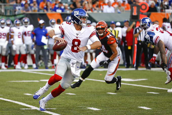 New York Giants quarterback Daniel Jones looks to pass on the run during the first half of the team's NFL preseason football game against the Cincinnati Bengals, Thursday, Aug. 22, 2019, in Cincinnati. (AP Photo/Frank Victores)