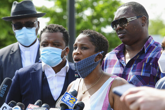 Kim Woods speaks with reporters in Chicago on Thursday, June 4, 2020. Several Chicago police officers are under investigation after a video surfaced showing them yanking women, including Woods, out of a car and throwing them to the ground in the parking lot of a shopping mall. (AP Photo/Teresa Crawford)