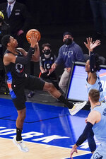 New York Knicks guard RJ Barrett (9) goes to the basket against Memphis Grizzlies guard Ja Morant to tie an NBA basketball game in the final seconds of the second half Friday, April 9, 2021, at Madison Square Garden in New York. (AP Photo/Mary Altaffer, Pool)