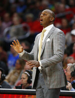 Memphis coach Penny Hardaway calls to the team during the first half of an NCAA college basketball game against Cincinnati, Saturday, March 2, 2019, in Cincinnati. (AP Photo/Gary Landers)