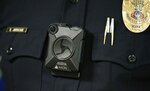 Phoenix Police Department Sgt. Kevin Johnson shows off the new Axon Body 2 body camera as another precinct gets their cameras assigned to them Wednesday, July 3, 2019, in Phoenix. Although body-worn cameras are becoming a police standard nationwide, Phoenix was among the last big departments to adopt their widespread use. (AP Photo/Ross D. Franklin)