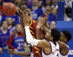 Iowa State forward Cameron Lard, left, tries to rebound over Kansas forward Dedric Lawson (1) and guard Ochai Agbaji, right, during the first half of an NCAA college basketball game in Lawrence, Kan., Monday, Jan. 21, 2019. (AP Photo/Orlin Wagner)