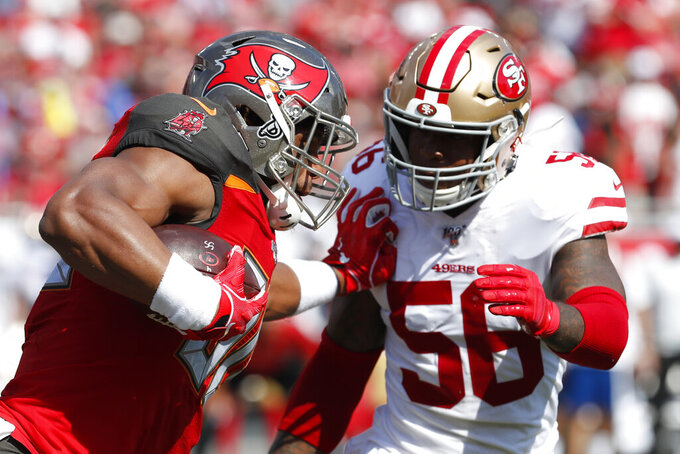 Tampa Bay Buccaneers tight end O.J. Howard (80) runs into San Francisco 49ers middle linebacker Kwon Alexander (56) during the first half an NFL football game, Sunday, Sept. 8, 2019, in Tampa, Fla. (AP Photo/Mark LoMoglio)