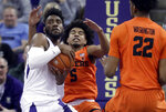 Washington guard Jaylen Nowell, left, grabs a rebound away from Oregon State guard Ethan Thompson (5) during the second half of an NCAA college basketball game Wednesday, March 6, 2019, in Seattle. Washington won 81-76 in overtime. (AP Photo/Ted S. Warren)