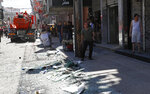 Palestinian merchants clean up their storefronts after an explosion in the Al-Zawiya market area of Gaza City, Thursday, July 22, 2021. At least one person was killed and some 10 injured Thursday when the explosion tore through a house in a popular market, the interior ministry said. (AP Photo/Adel Hana)