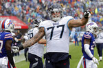 Tennessee Titans offensive tackle Taylor Lewan yells after a play in the second half of an NFL football game against the Buffalo Bills Sunday, Oct. 6, 2019, in Nashville, Tenn. (AP Photo/James Kenney)
