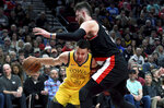 Golden State Warriors guard Stephen Curry, left, tries to get around Portland Trail Blazers center Jusuf Nurkic during the first half of an NBA basketball game in Portland, Ore., Wednesday, Feb. 13, 2019. (AP Photo/Steve Dykes)