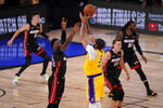 Los Angeles Lakers forward Anthony Davis makes a 3-point basket with 40 seconds left on the clock in Game 4 of basketball's NBA Finals against the Miami Heat Tuesday, Oct. 6, 2020, in Lake Buena Vista, Fla. (AP Photo/Mark J. Terrill)