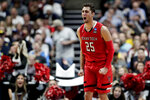 Texas Tech guard Davide Moretti celebrates after scoring against Michigan during the second half an NCAA men's college basketball tournament West Region semifinal Thursday, March 28, 2019, in Anaheim, Calif. (AP Photo/Jae C. Hong)