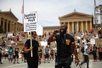 Wallace Weaver, of Mount Airy, Philadelphia, speaks on the microphone to encourage protestors demonstrating for justice after the death of George Floyd to register to vote at the Philadelphia Art Museum, Saturday June 6, 2020, in Philadelphia.