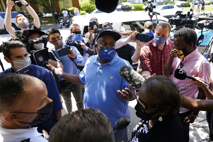 Elijah Dillard, center, is surrounded by media as he makes comments after a judges decision on the release body cam video of the shooting of Andrew Brown Jr. in Elizabeth City, N.C., Wednesday, April 28, 2021. A judge denied the request to immediately release body cam video of the incident. (AP Photo/Steve Helber)