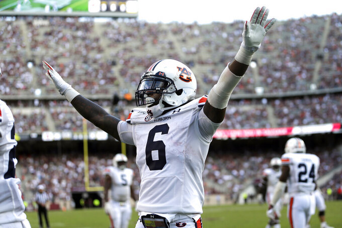 Auburn defensive back Christian Tutt (6) reacts after a pass is broken up in the end zone against Texas A&M during the second half of an NCAA college football game, Saturday, Sept. 21, 2019, in College Station, Texas. (AP Photo/Sam Craft)