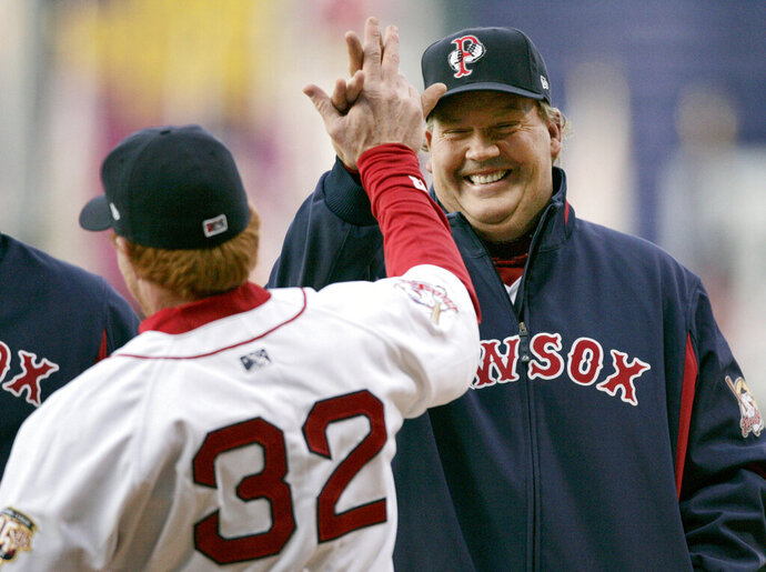 FILE - In this Thursday, April 3, 2008 file photo, Pawtucket Red Sox manager Ron Johnson, right, welcomes Paw Sox outfielder Bobby Kielty, left, to the field during ceremonies before the team's home opener against the Indianapolis Indians in a minor league baseball game, in Pawtucket, R.I. Ron Johnson, who spent 25 seasons as a minor league manager, most recently for the Triple-A Norfolk Tides in the Baltimore Orioles system, died on Tuesday, Jan. 26, 2021. He was 64. (AP Photo/Steven Senne, File)