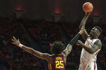 Illinois' Kofi Cockburn (21) puts up a one-handed shot as Minnesota's Daniel Oturu (25) defends in the first half of an NCAA college basketball game, Thursday, Jan. 30, 2020, in Champaign, Ill. (AP Photo/Holly Hart)