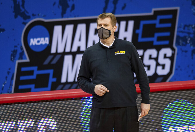 Appalachian State head coach Dustin Kerns watches the action on the court during the first half of a First Four game against Norfolk State in the NCAA men's college basketball tournament, Thursday, March 18, 2021, in Bloomington, Ind. (AP Photo/Doug McSchooler)