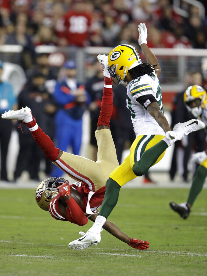 San Francisco 49ers wide receiver Emmanuel Sanders, bottom, falls to the ground in front of Green Bay Packers cornerback Kevin King during the first half of an NFL football game in Santa Clara, Calif., Sunday, Nov. 24, 2019. (AP Photo/Ben Margot)
