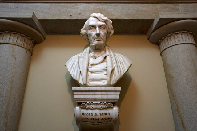 FILE - In this March 9, 2020 file photo, a marble bust of Chief Justice Roger Taney is displayed in the Old Supreme Court Chamber in the U.S. Capitol in Washington. The House will vote on whether to remove from the U.S. Capitol a bust of Chief Justice Roger B. Taney, the author of the 1857 Dred Scott decision that declared African Americans couldn't be citizens. The vote expected Wednesday comes as communities nationwide reexamine the people memorialized with statues. (AP Photo/J. Scott Applewhite)