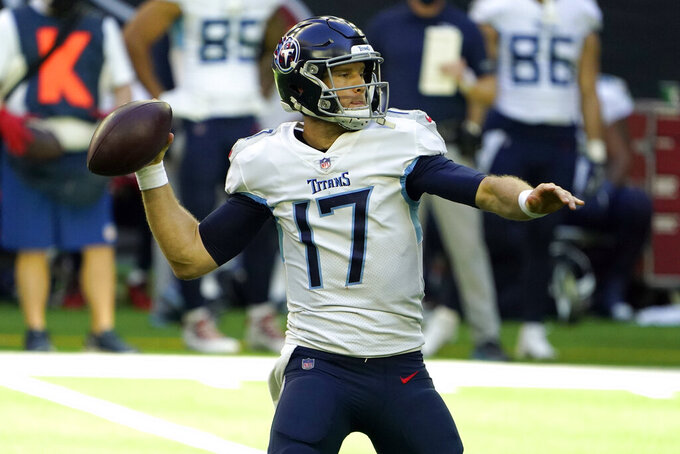 Tennessee Titans quarterback Ryan Tannehill (17) throws a pass against the Houston Texans during the first half of an NFL football game Sunday, Jan. 3, 2021, in Houston. (AP Photo/Eric Christian Smith)