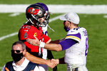 Tampa Bay Buccaneers quarterback Tom Brady (12) shakes hands with Minnesota Vikings quarterback Kirk Cousins (8) after an NFL football game Sunday, Dec. 13, 2020, in Tampa, Fla. (AP Photo/Mark LoMoglio)