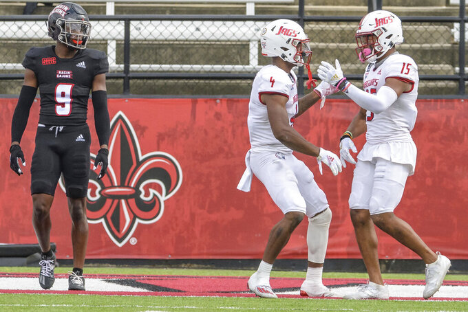 South Alabama wide receiver Kawaan Baker (15) celebrates a touchdown with teammate Jalen Wayne (4) next to Louisiana-Lafayette safety Percy Butler (9) during the first half an NCAA college football game in Lafayette, La., Saturday, Nov. 14, 2020. (AP Photo/Matthew Hinton)