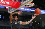 Wake Forest guard Sharone Wright Jr. (2) scores during the first half of an NCAA college basketball game against Georgia Tech, Saturday, Jan. 5, 2019, in Atlanta. (AP Photo/John Bazemore)