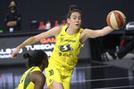 Seattle Storm forward Breanna Stewart (30) saves a ball from going out of bounds by tipping it to guard Jewell Loyd (24) during the first half of Game 2 of basketball's WNBA Finals against the Las Vegas Aces, Sunday, Oct. 4, 2020, in Bradenton, Fla. (AP Photo/Phelan M. Ebenhack)