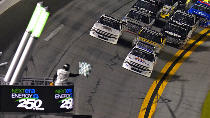 Raphael Lessard (24) beats the field to the line to win the first stage during a NASCAR Camping World Truck Series auto race Friday, Feb. 12, 2021, at the Daytona International Speedway in Daytona Beach, Fla. (AP Photo/Chris O'Meara)