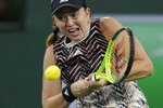 Jelena Ostapenko, of Latvia, returns a shot to Shelby Rogers at the BNP Paribas Open tennis tournament Wednesday, Oct. 13, 2021, in Indian Wells, Calif. (AP Photo/Mark J. Terrill)